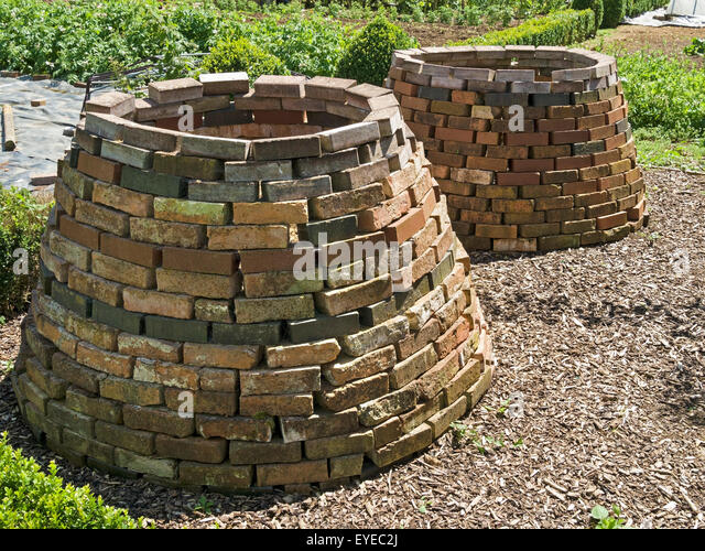 old victorian style brick compost bins barnsdale gardens england uk stock
