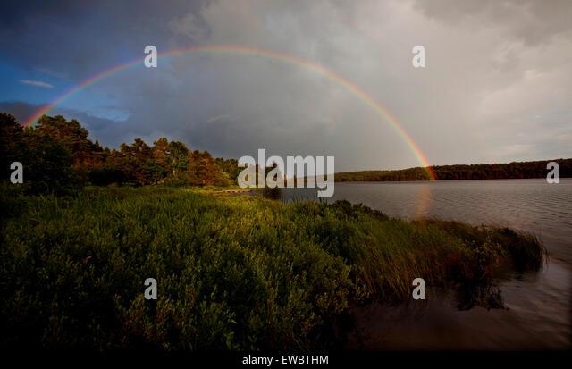 Rainbow After Rain Over Lake Stock Photos & Rainbow After Rain ...