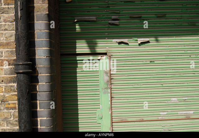 Close up garage of Kings Works Carpenter\u0027s Road with Judas door - Stock Image & Judas Door Stock Photos \u0026 Judas Door Stock Images - Alamy Pezcame.Com