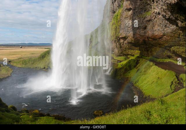 Seljalandsfoss waterfall bridge iceland stock photos for Waterfall environment