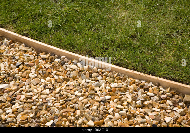 Gravel path with wooden lawn edging stock photo picture for Path and border edging