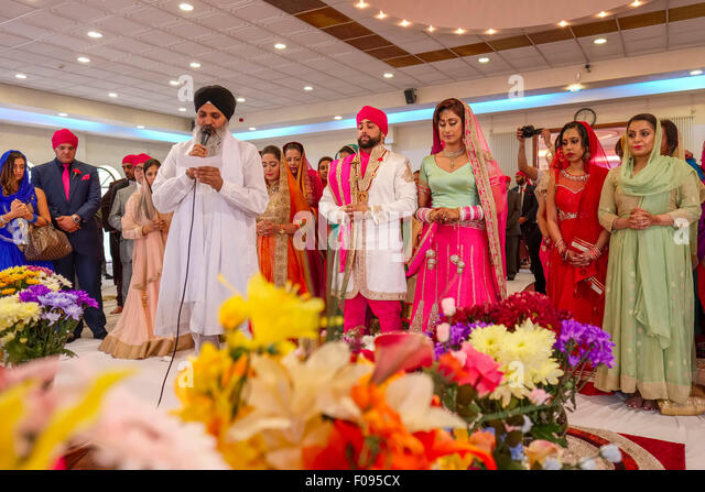 Priest With Bride And Groom At Sikh Wedding Ceremony In Brent Gurdwara London