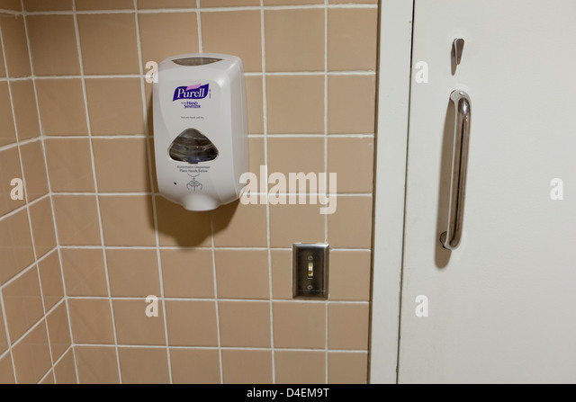 Hand Sanitizer On Public Restroom Wall