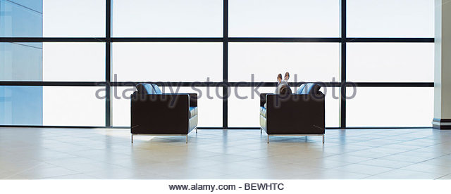 businesswoman napping in office waiting area stock image business nap office relieve
