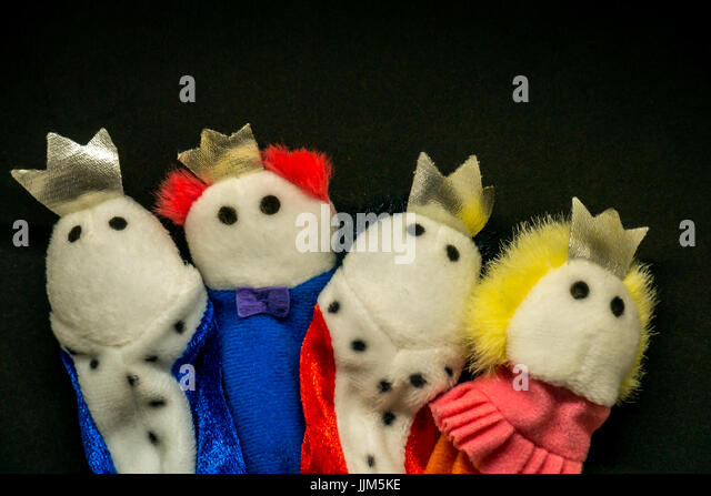 Still life of royal finger puppets with king, queen, prince, princess to represent family, royal, royals, parents, - Stock Image