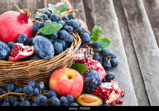 Fresh autumn red and green apples and dark grapes