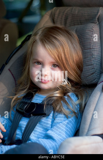 Beautiful Blond 3 Year Old Girl Strapped Into Car Seat