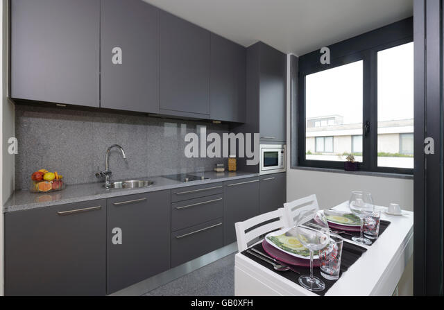 Small Modern Grey Kitchen With Dining Table   Stock Image