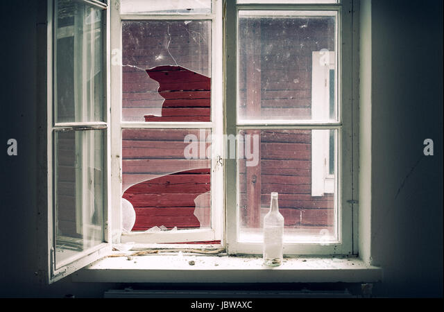 Broken window in the abandoned house - Stock Image