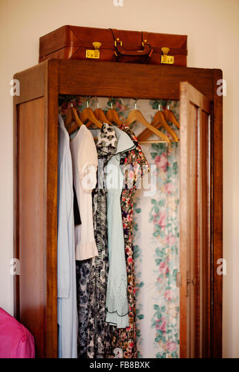 italy liguria imperia diano marina clothes hanging in open wooden wardrobe