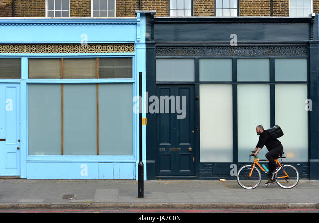Colourful shop fronts on Kennington Road, LOndon - Stock Image