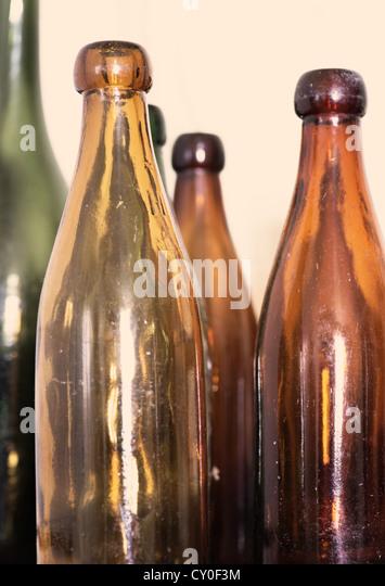 Antique beer bottles stock photos antique beer bottles for Uses for old glass bottles