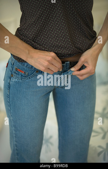 skinny jeans women stock photos skinny jeans women stock images alamy. Black Bedroom Furniture Sets. Home Design Ideas