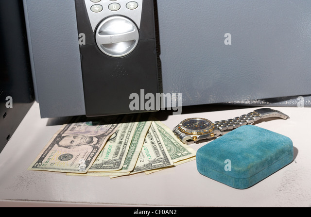 hiding us dollars cash and other valuables in a small home safe stock image
