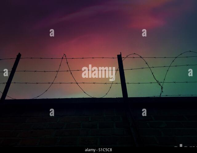 Beautiful Prison Fence At Night Against A Sky Stock Image And Design