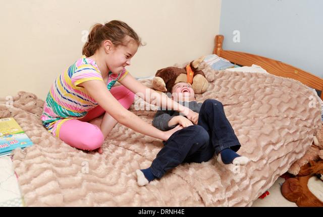 Asian girl tickled in socks