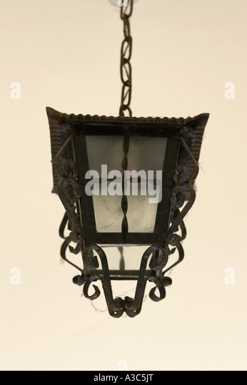Old style lamp shade stock photos old style lamp shade stock old fashioned wrought iron lamp shade hanging in the porch of a house in tenerife canary mozeypictures Gallery