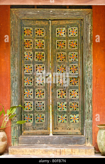 The exterior colorful carved wooden doors of an entranceway in Southeast Asia. - Stock & Hand Carved Wooden Doors Stock Photos \u0026 Hand Carved Wooden Doors ... Pezcame.Com