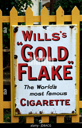 Old advertisements for Will's Gold Flake cigarettes - Stock Image