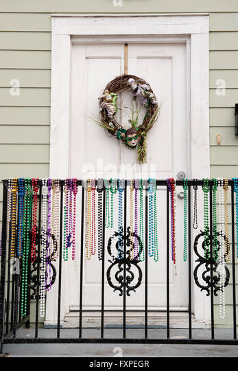 Festive wreath and mardi gras beads on entrance to home   Stock Image. Door Beads Stock Photos   Door Beads Stock Images   Alamy