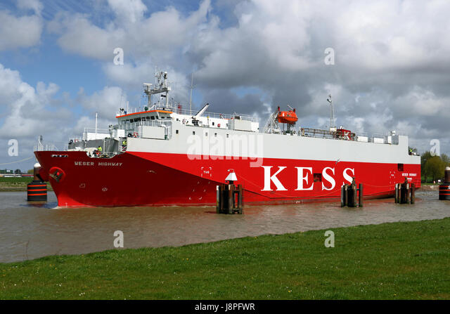 The Ro-Ro ship Weser Highway leaves the port of Emden. - Stock Image