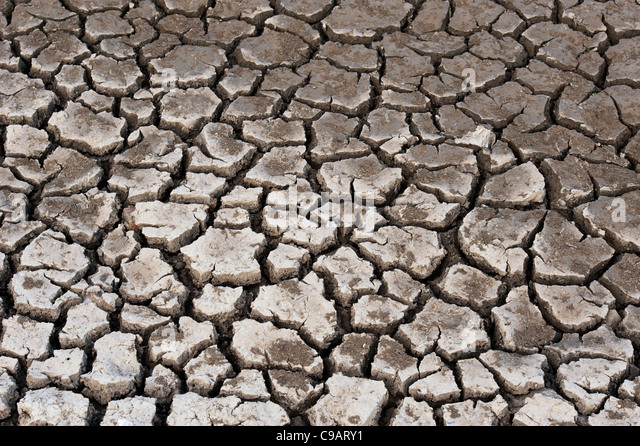 Dried mud clay stock photos dried mud clay stock images alamy dry cracking clay soil pattern stock image sciox Images