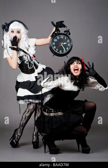 http://l7.alamy.com/zooms/65fcf8f76ce54511a71659e582508b9a/gothic-dressed-teenager-holding-a-very-noisy-alarm-clock-baad7m.jpg