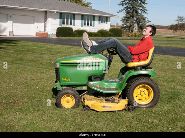 Man On Tractor Lawn Enforcment : Lawn mower building stock photos
