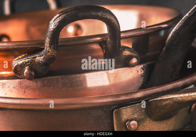 copper pots and pans horizontal stock image - Copper Pots