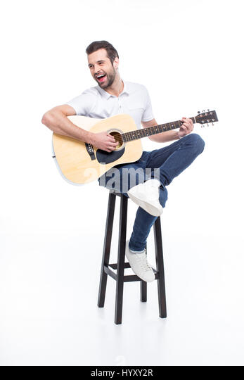 Guitar Stool Stock Photos amp Guitar Stool Stock Images Alamy : laughing young man playing guitar while sitting on stool hyxy2r from www.alamy.com size 347 x 540 jpeg 18kB