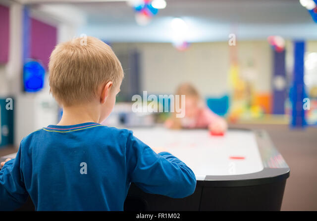 Children Playing Ice Hockey Table Board Game.   Stock Image