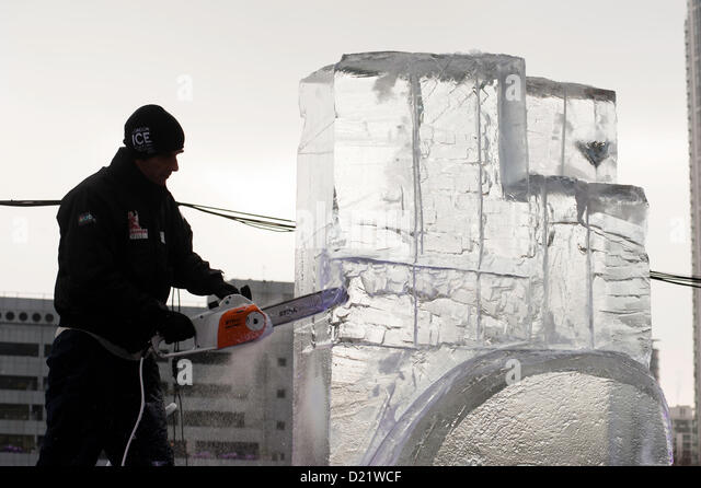Ice sculpture chainsaw stock photos