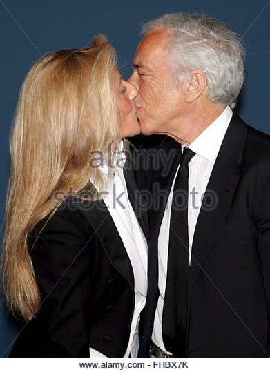 Ralph Lauren (R) kisses his wife Ricky at the opening ceremony of the Ralph