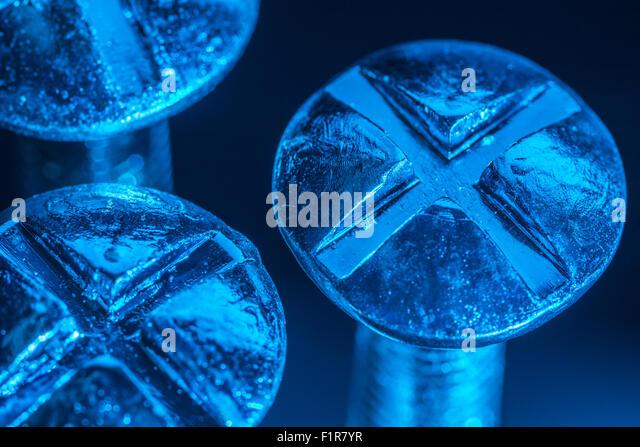 set of bolt heads taken under artificial lighting macro photo stock image artificial lighting set