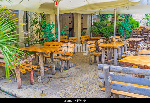 The Timbered Tables And Chairs In Outdoor Terrace Of Cafe German Colony Haifa