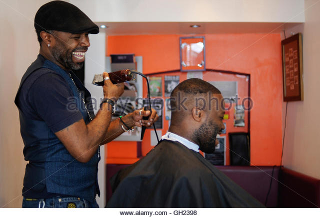how much is a haircut at cost cutters west indian barber shop stock photos amp west indian barber 2398 | a man has his hair cut at a west indian barber shop off portobello gh2398