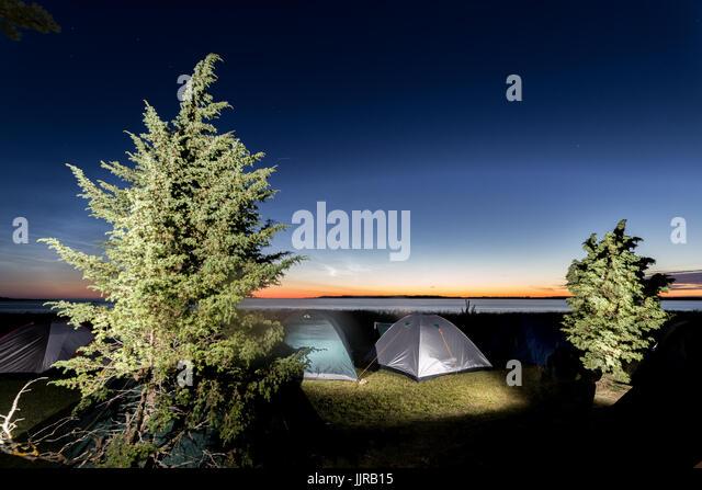 Camping near seashore at twilight - Stock Image