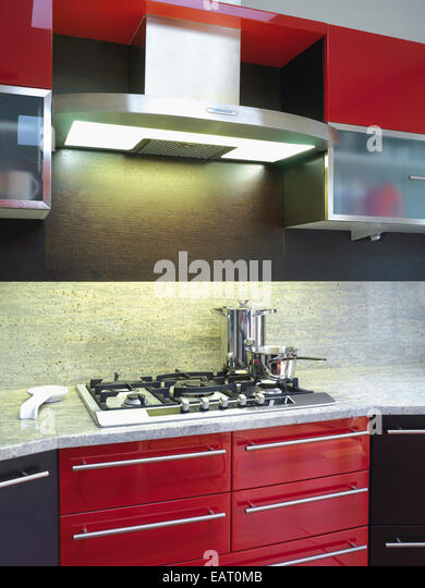 Kitchen gas hob unit worktop stock photos kitchen gas for Red fitted kitchen