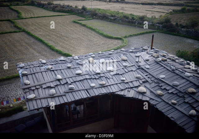Traditional Roofing Methods Of Bhutan,no Nails,just Planks Weighted With  Large Stones,