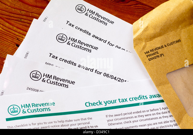Tax uk envelope stock photos tax uk envelope stock images alamy close up of uk tax credits award from hm revenue and customs with brown official envelope sciox Image collections