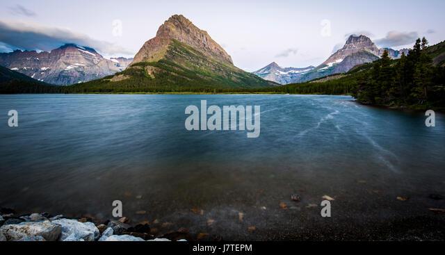 Many Glacier Glacier National Park Mountain Landscapes Sunrise Swiftcurrent lake Grinnell Point - Stock Image
