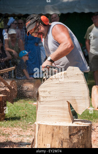 Carving with chainsaw stock photos