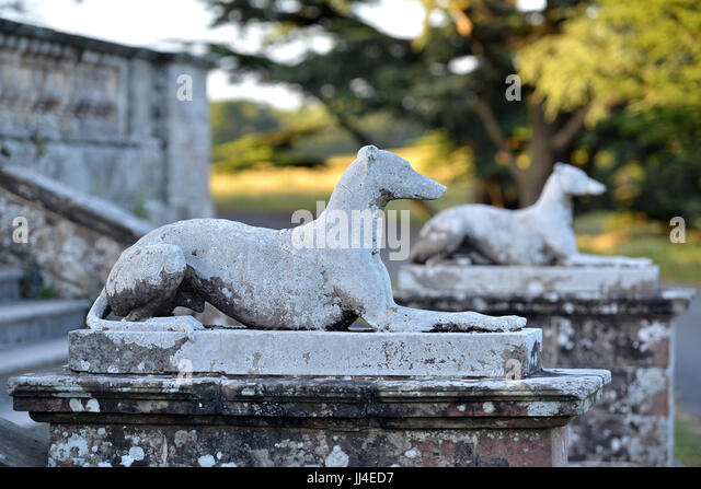 Two Greyhound Statues In A Formal Garden   Stock Image