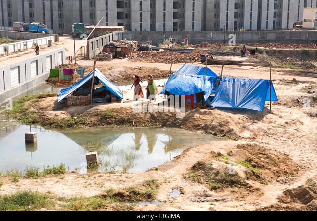 Temporary Construction Tents : Temporary workers stock photos