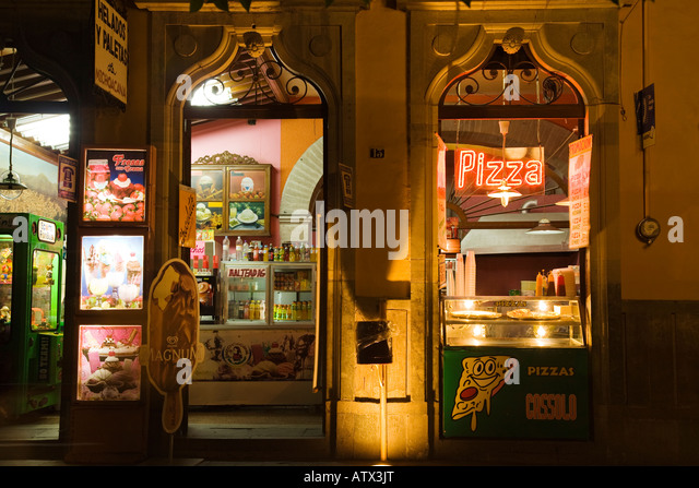 MEXICO Guanajuato Neon signs for pizza retail shop selling pizza and ...