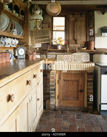earthenware sink and antique pine dresser in small cottage kitchen stock image - Small Cottage Kitchen