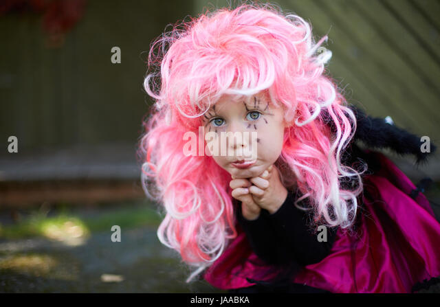 Portrait of cute girl in Halloween costume and pink wig looking at camera - Stock Image  sc 1 st  Alamy & Halloween Girl In Pink Wig Stock Photos u0026 Halloween Girl In Pink Wig ...
