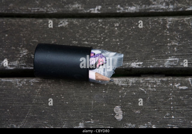open-film-canister-showing-contents-used-for-geocaching-cbyd80.jpg