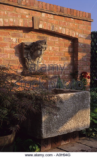 wall mounted water fountain design clare whitehouse old stone trough brick wall on patio stock