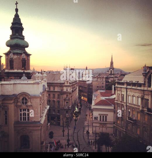 Sunset View Of University Square And Church From A Rooftop Bar In Budapest.    Stock